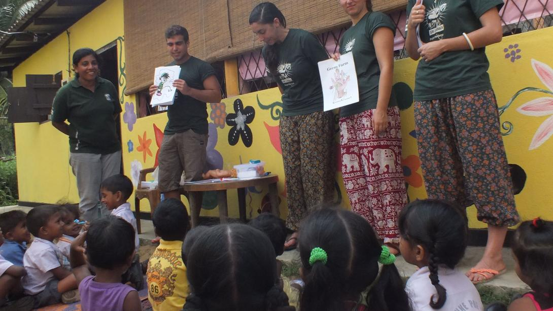 Conservation volunteers talk to the community about the importance of elephant conservation.